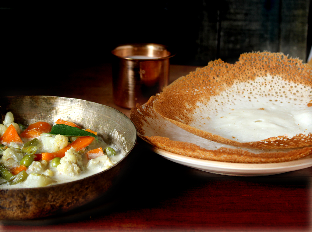 Appam with vegetable stew